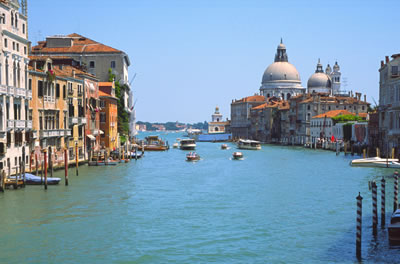 The Grand Canal in Venice, with the dome of St. Mark\'s in the background