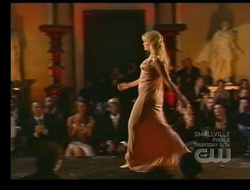 Walking the runway in a Versace dress on the final episode; click to enlarge